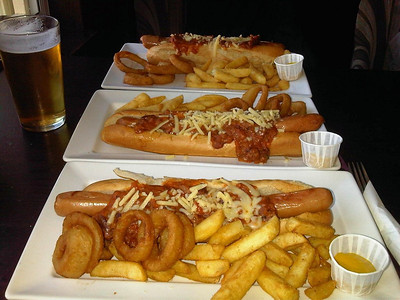 "Gourmet Hot Dog with  chilli con carne and cheese. Served with onion rings and chips. Served in ""Wetherspoons""  02/05/13"