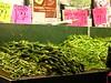 Outdoor arrangement of vegetables: okra, rech, small chilli, green peas, methi.  I buy the okra.