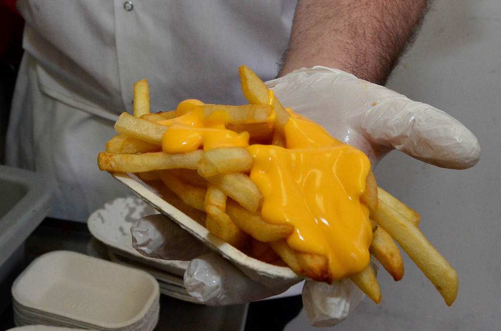 . Mike McMahon - The Record, Cheese fries at Jack\'s Drive-In opens for it\'s 76th season in Wynantskill, Wednesday March 13, 2014.