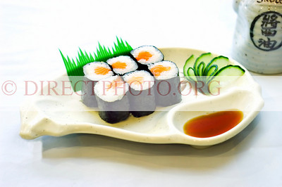 Japanese Food, Plate of Maki, Sliced Raw Fish, Salmon, in Rolled Rice and Seaweed