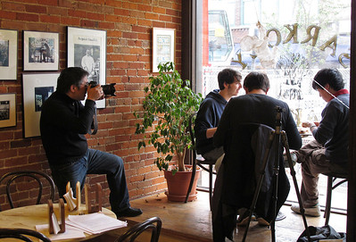 Kevin Miyazaki, left, a Milwaukee-based freelance photographer on assignment for Midwest Living magazine, shoots pictures on Oct. 20, 2010 in Sarkozy Bakery for a planned July/August story on Kalamazoo, Michigan. (Bradley S. Pines | Special to the Kalamazoo Gazette)