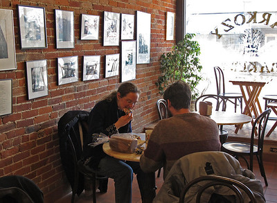 Regulars enjoy fresh pizza in Sarkozy Bakery on March 1, 2011. (Bradley S. Pines | CONTACT: bspines@gmail.com)