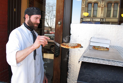 One of Judy Sarkozy's bakers pulls a fresh pizza from the outside oven on March 1, 2011.  (Bradley S. Pines | CONTACT: bspines@gmail.com)