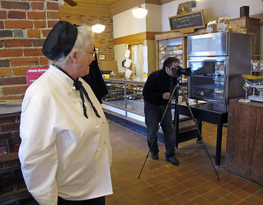 Judy Sarkozy looks on as Kevin Miyazaki, a Milwaukee-based freelance photographer on assignment for Midwest Living magazine, shoots pictures in Sarkozy Bakery on Oct. 20, 2011 for a planned July/August story on Kalamazoo.  (Bradley S. Pines | CONTACT: bspines@gmail.com)