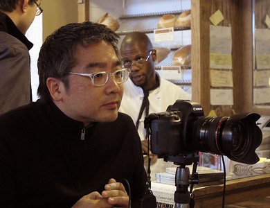 Kevin Miyazaki, a Milwaukee-based freelance photographer on assignment for Midwest Living magazine, shoots pictures in Sarkozy Bakery on Oct. 20, 2011 for a planned July/August story on Kalamazoo.  (Bradley S. Pines | CONTACT: bspines@gmail.com)