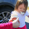 Olivia Carlson, 2,  enjoyed some ice cream as Kimball Farm, on Route 70 in Lancaster, when it opened Thursday to started serving ice cream for the new season. SENTINEL & ENTERPRISE/JOHN LOVE