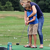 Kimball's Ice Cream in Westord, for story on area ice cream stands. Jessica Shandrowski of Townsend helps her son Jackson, 7, hit golf balls at the driving range. (SUN/Julia Malakie)