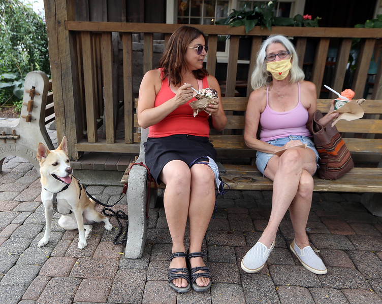 Kimball's Ice Cream in Westord, for story on area ice cream stands. C.G. Finigan of Stow, left, eating peppermint stick ice cream, with her Carolina dog, Lu, and her mother Dorothy Finigan of Harvard, eating kiwi sorbet. (SUN/Julia Malakie)