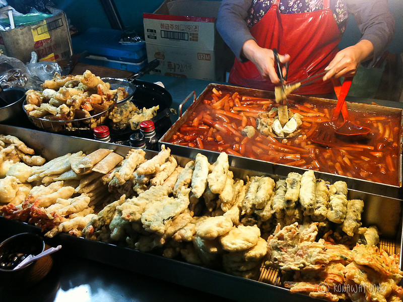 Streetfood stand with Tteokboki and fried vegetables