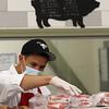 Alpine Butcher employee Juan Mercade checks an order. (SUN/Julia Malakie)