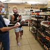 Shervin Ayati of Carlisle and Tiffany Foster of Dracut, who didn't know each other, share thoughts on what kind of barbecue sause to buy. (SUN/Julia Malakie)