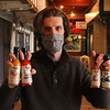 Brian Ruhlmann of Lowell, with the Irish hot sauces he's developed, called Craic Sauce. The latest to be released is Brian Boru Sauce. (SUN/Julia Malakie)