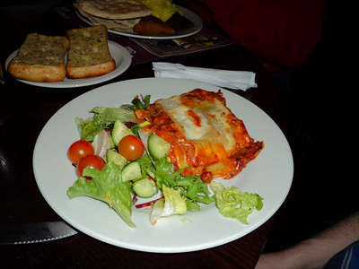 "Lasagne - Baked layers of egg pasta, with beef and bacon in a tomato, red wine, olive oil & herb sauce, topped with four cheeses and served with a side sala. Served in ""Weatherspoons"" 10/03/11"