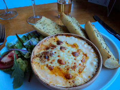 "Lasagne - pasta layers with lean beef, tomatoes and onion topped with cream and melted cheese, served with salad and garlic bread. £8.95.  Served in ""The Babbacombe Inn"" in Torquay  05/07/14"