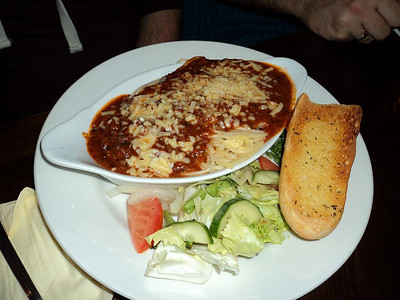 "Beef Lasagne - Layers of pasta and rich Bolognese topped with a creamy cheese sauce, served with garlic bread and a dressed salad. £8.25.  Served in ""Crosskeys"" in Taunton  21/10/13"