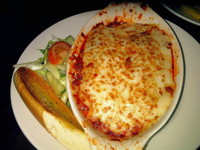 "Beef Lasagne - Layers of pasta and rich Bolognese topped with a creamy cheese sauce, served with garlic bread and a dressed salad. £8.25. Served in ""Cross Keys"" near Taunton  15/06/12"