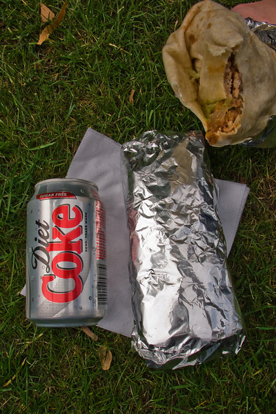 The sheer size and magnitude of these burritos must be sufficiently described. A soda can suffices for scale.
