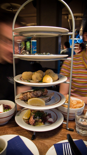 Plates of appetizers at The Real Greek. That's Martin on the left and Davi on the right.
