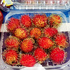 Globe/T. Rob Brown<br /> A plastic tray filled with rambutan fruit for sale Wednesday morning, Aug. 7, 2013, at Marian Days in Carthage.