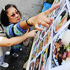 Globe/T. Rob Brown<br /> Lina Parsons (left) of Carthage and friend Aida Byrd of Joplin look over the many menu options to decide on a Vietnamese meal Wednesday afternoon, Aug. 7, 2013, at Marian Days in Carthage.