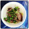 Globe/T. Rob Brown<br /> A dish of rice porridge with pork liver, kidney and heart, called chao long, Wednesday morning, Aug. 7, 2013, at Marian Days in Carthage.