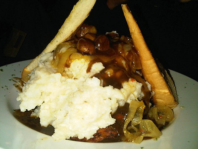 "Meatloaf - topped with mashed potatoes, mushrooms, onions and gravy. C$14.99.  Served in the ""Waltzing Weasel"" in London, Ontario  05/02/14"