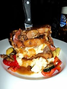 "Meat Loaf - Panko onion rings, mashed potatoes & pan gravy. C$17.49.  Served in ""Crossings"" in London, Ontario  29/01/14"