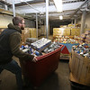 Merrimack Valley Food Bank warehouse assistant Brandon Crocker of Pepperell shifts bins of donated food upstairs for storage and sorting. (SUN/Julia Malakie)