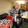 Merrimack Valley Food Bank assistant director Debbie Callery of Lowell, with a bin of donated food items.(SUN/Julia Malakie)