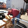 Organizations continue to pick up food for local food pantries from the Merrimack Valley Food Bank. Jay Looney of Dracut loads food for the St. Mary Magdalen of Tyngsboro food pantry. It was their regular Wednesday pickup. (SUN/Julia Malakie)