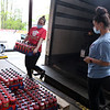 Merrimack Valley Food Bank in Lowell is celebrating its 30th anniversary in 2021. Warehouse workers Danielle Landry and Kiara Velazquez, both of Lowell, unloads packs of Mountain Dew that needed to be unloaded by hand because they slipped on the pallet jack. JULIA MALAKIE/LOWELLSUN