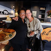Mill City BBQ at its new location at 11 Kearney Square in Lowell. Owner Renay Wolterding, left, with a serving of Chicken & Waffles, and first-time customer Karen Dunn of Bedford, who stopped in because she was hungry and told Wolterding how much she enjoyed the meal. (SUN/Julia Malakie)