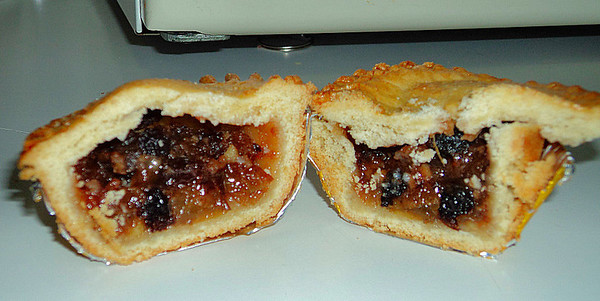 Marks & Spencers Truly Indulgent All Butter Mince Pie - All butter pastry mince pie deep fillled with mincement made with sultanas, currants, raisins, almonds and fried apricots and lashing of brandy and port 30/12/11