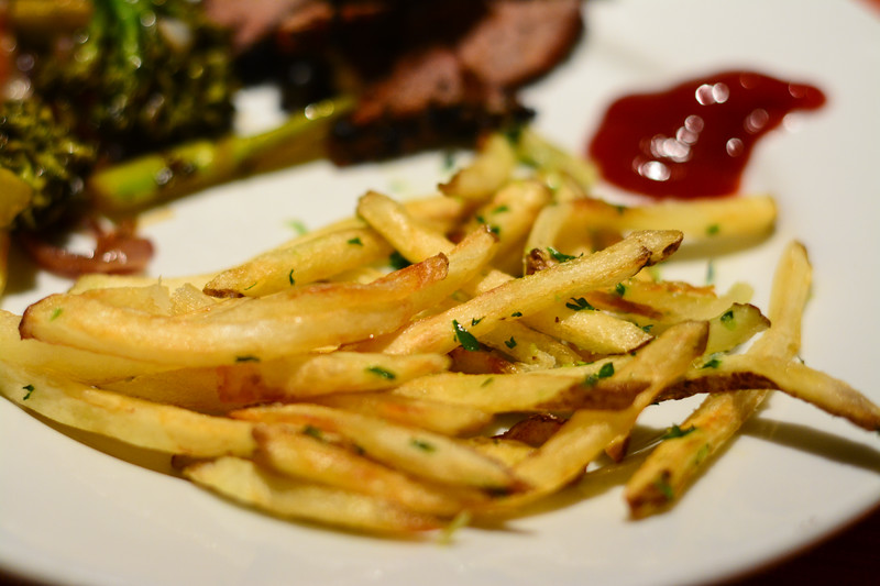 fresh cut deep fried fries with garlic and parsley