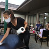 Moonstones restaurant in Chelmsford is open for outdoor dining as part of phase 2 of reopening the economy during the COVID-19 pandemic. Host/runner Emily Crain of Chelmsford cleans a table and chairs between customers.  (SUN/Julia Malakie)