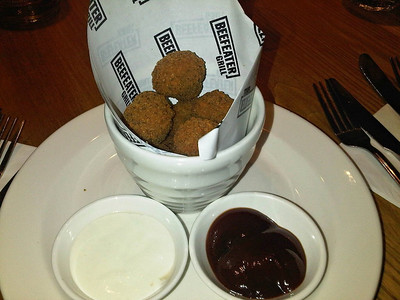 "Garlic & Herb Breaded Mushrooms - Button mushrooms coated in garlic & herb breadcrumbs, deep fried and served with smoky BBQ sauce and garlic mayo dip on the side.  Served in ""Beefeater""  26/02/14"