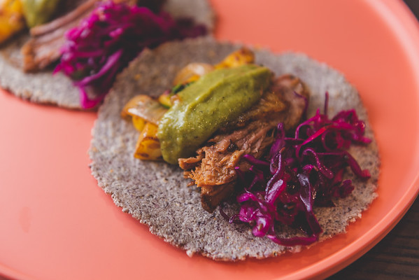 Homemade blue corn tortillas, braised beef shortribs, cabbage slaw, roasted tomatillo salsa