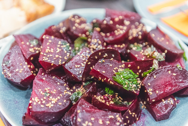 salt roast beets with herb oil, mint, and sesame