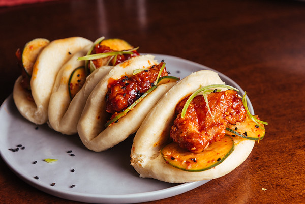 korean fried chicken bao with pickled cucumber