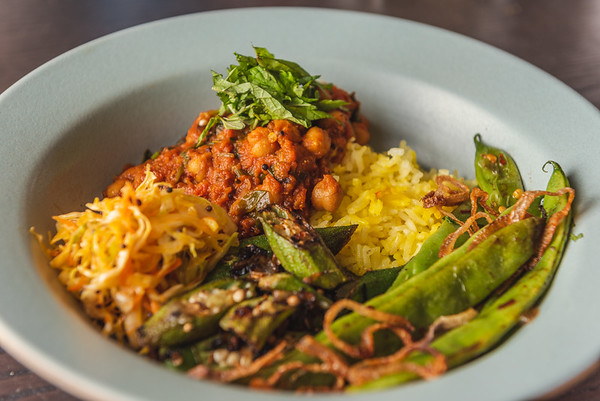 chichpea curry, carrot and cabbage slaw, sour okra, romano beans with crisped shallots