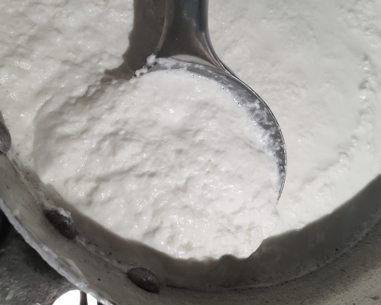 Let the curd start to pile up and then gently take it out with a large slotted spoon.