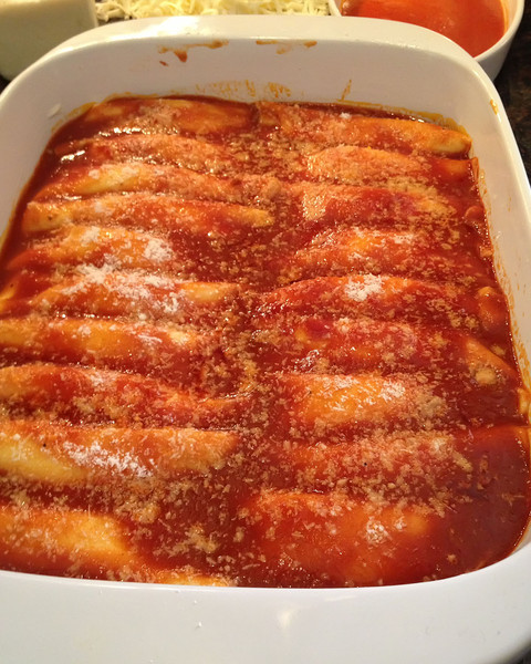 Cover with sauce and more romano and back for 45 min at 350 or until nice & bubbly.
