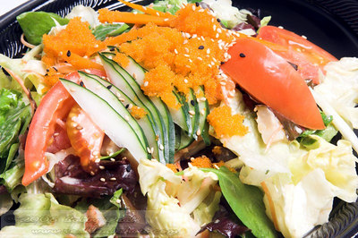 Asain salad greens with tomatoes, cucumber, carrot, lettuce, field greens and smelt roe
