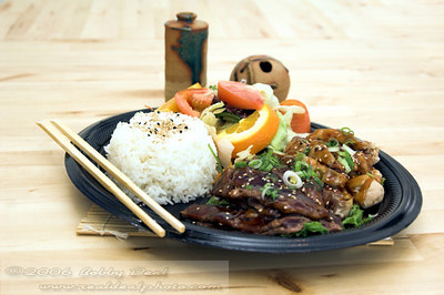 Combo Teriyaki plate with beef and chicken teriyaki, asian soy ginger salad, steamed rice and oranges