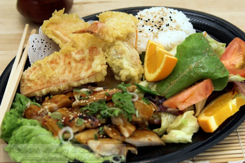 Combo MisoYaki Chicken combo plate with tempura shrimp, tempura vegetables and an asian soy ginger salad, steamed rice and oranges