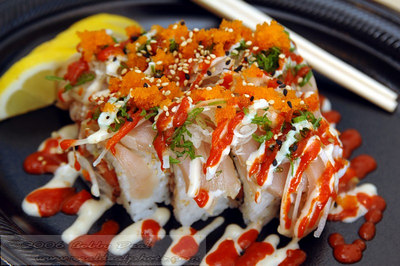 Tataki Special Sushi Roll. Spicy tuna in sushi rice with seared albacore, chopped onions, smelt roe, chili and mayonaise sauce