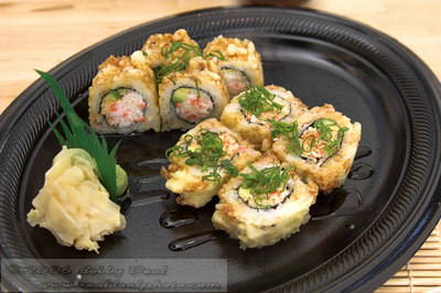 Baked California sushi roll with wasabi and pickled ginger