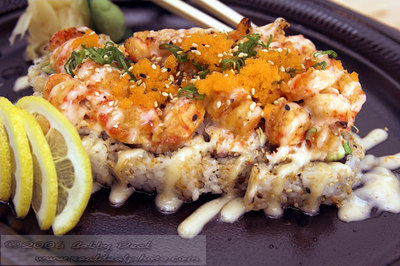 Baby Lobster sushi roll with wasabi, pickled ginger and lemon
