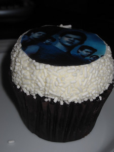 Devils' food cupcake with buttercream frosting and vanilla jimmies.