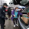 O & O's For A Cause holds a food drive outside of Owen & Ollie's restaurant, with donations going to the Dracut Food Pantry. Harry Gorman of Dracut, left, co-owner of Owen & Ollie's, accepts a box from Nicole Guiliano of Dracut, cent. At rear are helpers Mia Ciccarelli and David Ignacio, both of Dracut. (SUN/Julia Malakie)